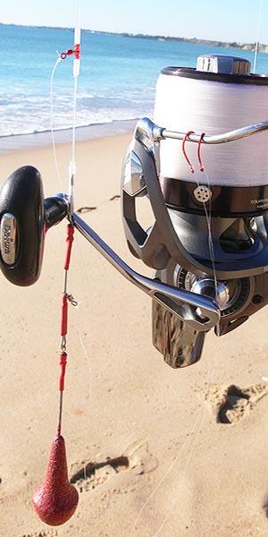 Caña carrete pesca herraras surfcasting