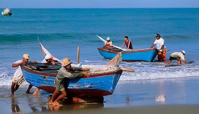 Pescadores en la costa